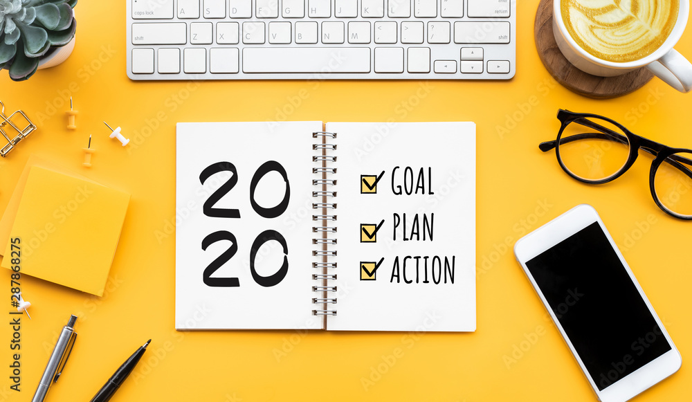 Fototapeta 2020 new year goal,plan,action text on notepad with office accessories.Business motivation,inspiration concepts