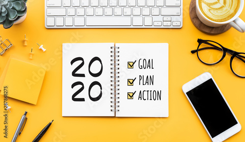 2020 new year goal,plan,action text on notepad with office accessories Canvas Print