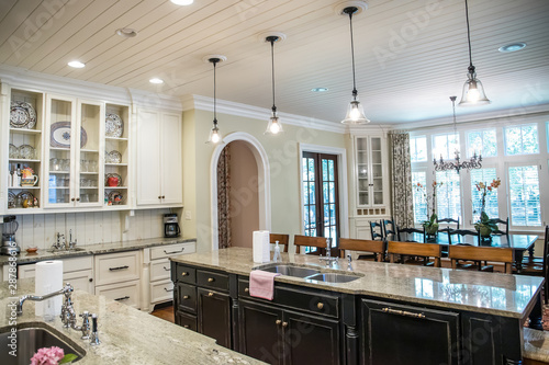 Vászonkép large kitchen with eat-in dining at spacious granite countertop and barstools