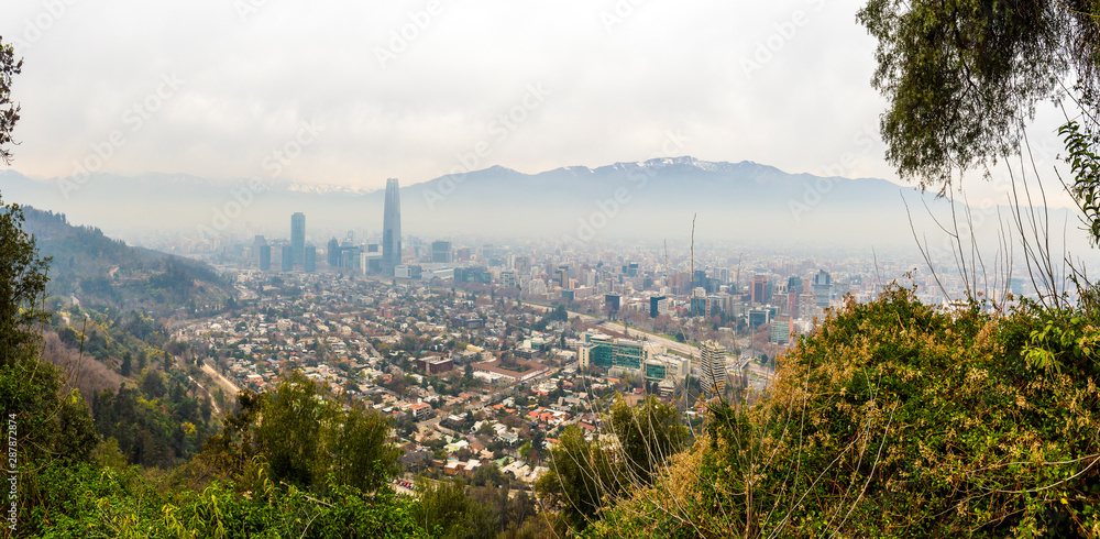 Fototapety, obrazy: Panoramic view of Santiago's pollution with the Andes Mountains as background from San Cristobal Hill in Chile.
