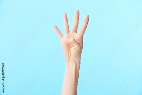 human hand showing number four