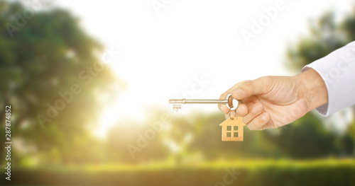 Real estate agent handing over house keys Canvas Print