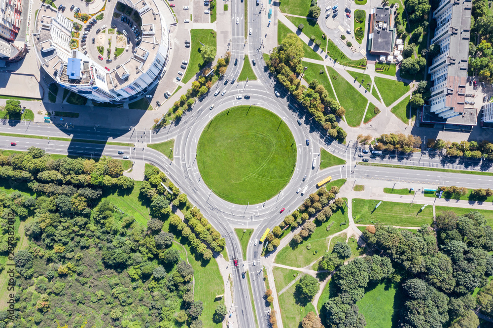 Fototapety, obrazy: aerial view of a traffic roundabout on road in an urban area