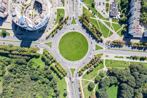 Fotografie, Obraz  aerial view of a traffic roundabout on road in an urban area