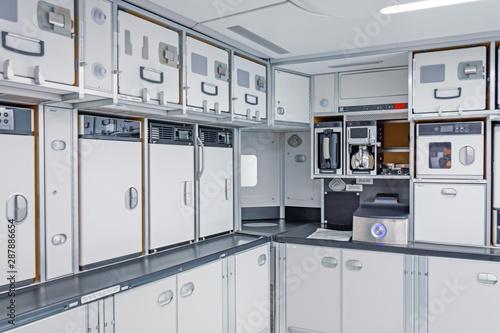 Preparing food for the passengers in the empty kitchen corner inside airplane Slika na platnu