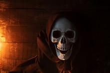 Halloween Costume Ghost Scary Skeleton Wearing A Hooded Coat - Grim Reaper With Skull In Black Hood On The Dark