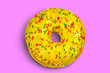 Leinwanddruck Bild - Sweet green donut with multicolored sprinkles on a pink background flat lay stock photo