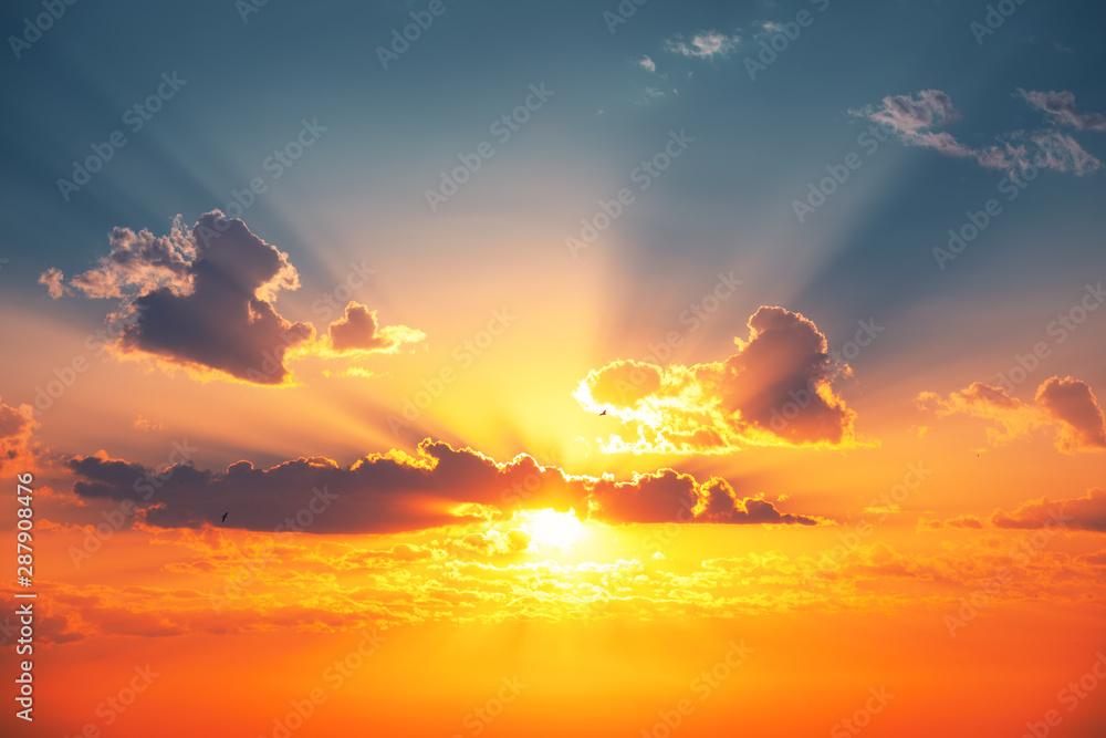 Fototapeta Sunset dramatic sky clouds with sunbeam