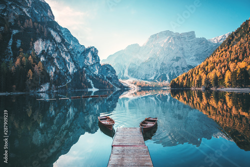 Boats on the Braies Lake ( Pragser Wildsee ) in Dolomites mountains, Sudtirol, Italy #287909239