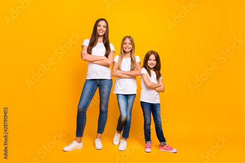 Fotografie, Obraz Full body photo of three sister ladies self-confident crossing arms wear casual