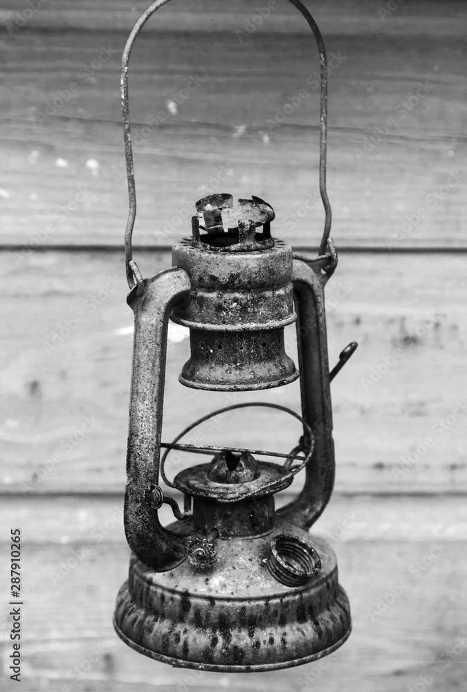 Fototapeta Old rusted red kerosene lamp