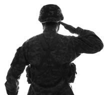 Silhouette Of Saluting Soldier...