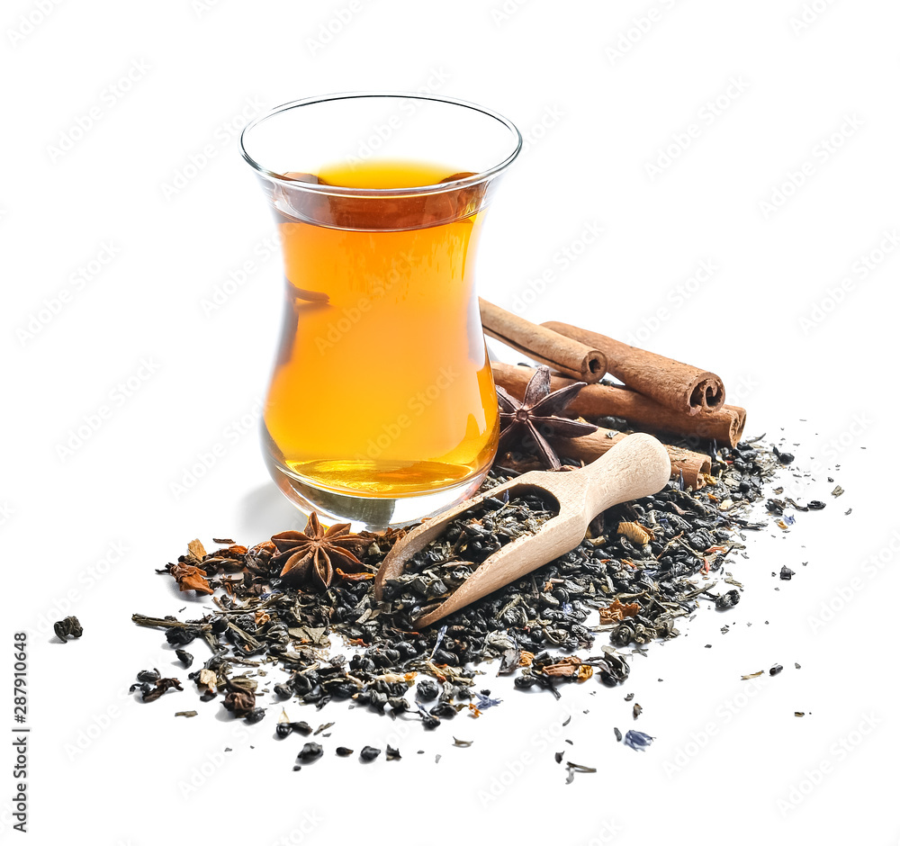 Fototapety, obrazy: Glass cup of tasty tea with spices on white background