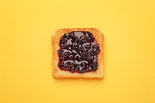 Tasty Toasted Bread With Jam On Color Background