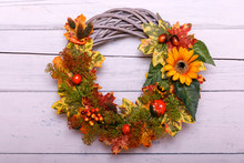 Vintage Autumn Wreath From Leaves And Flowers On Shabbi Wooden Backgorund
