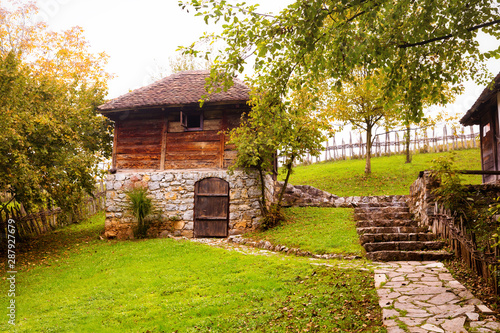 Old, traditional wood and stone peasant house. Wallpaper Mural