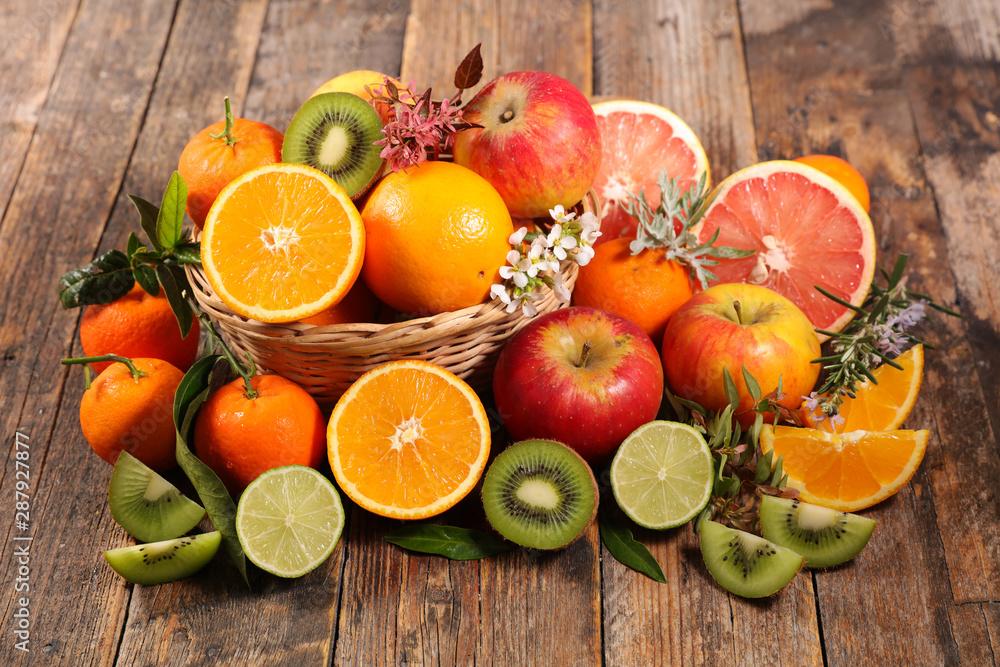 Fototapeta assorted of fruits, orange with apple, kiwi and clementine