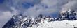 Leinwanddruck Bild Snowy rocks in haze at sunny day