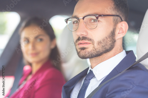 Fototapety, obrazy: Bearded young man wearing glasses sitting near wife in car