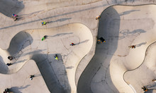 Skate Park Top View. Young People Doing Sport Riding Skaters Bicycles And Scooters. Aerial Top View. Creative Street Photo New Concept