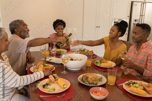 Multi-generation family having meal together on dining table