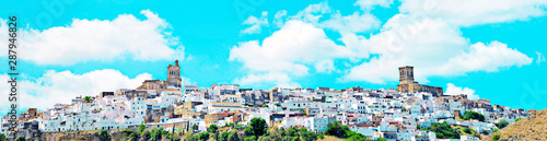 Fotobehang Turkoois Blue sky and white clouds on the Church of Arcos de la Frontera in a hillside