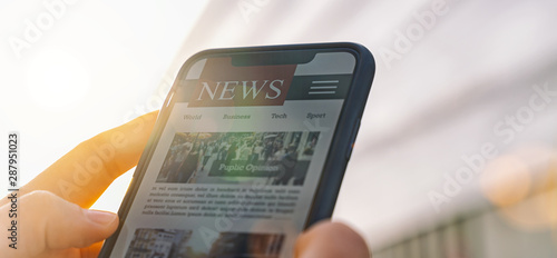 Foto auf Leinwand Texturen Online news article on smartphone screen. Electronic newspaper or magazine. Latest daily press and media. Mockup of digital portal and website. person using web service in the morning. Reading text.