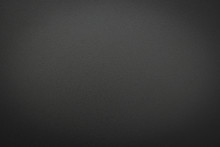 Close-up Of Black Gray Metal Texture. Surface Of Rough Abstract Dark Black Matte Background. Design In Your Work Backdrop, Concept Copy Space For Text.