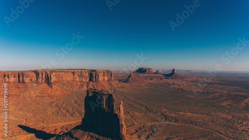 Keuken foto achterwand Afrika Bird's eye view of beautiful landscapes of southwest USA with blue sky on horizon.Aerial view of endless Monument Valley desert of Utah state