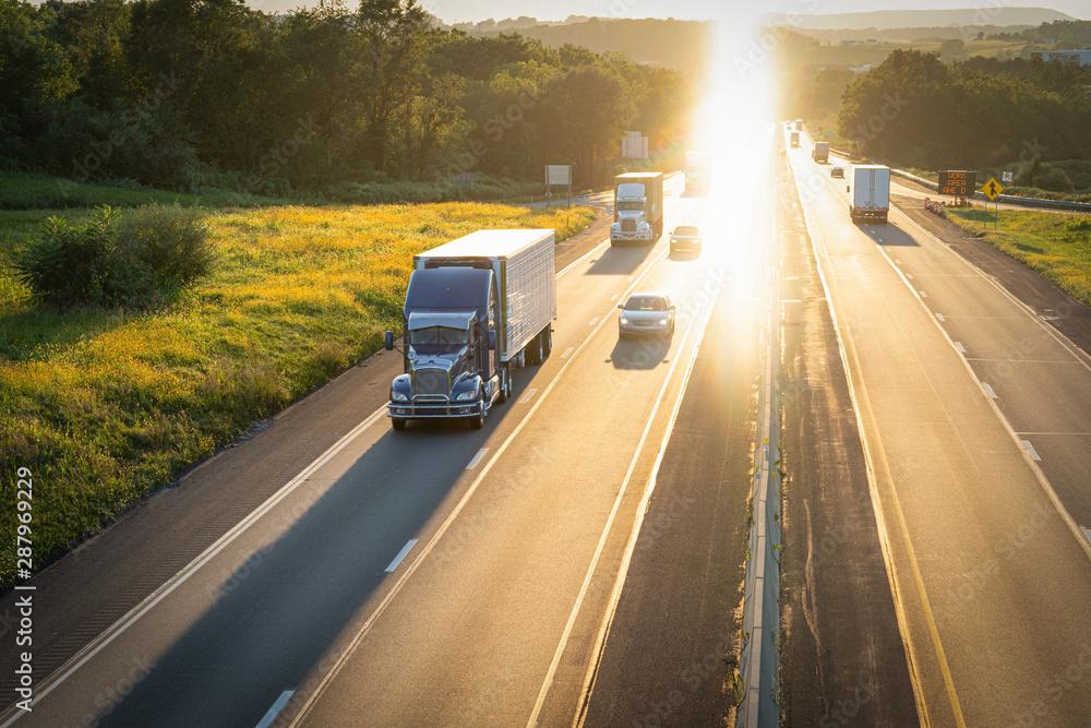 Fototapety, obrazy: Semi truck 18 wheeler on highway at sunset