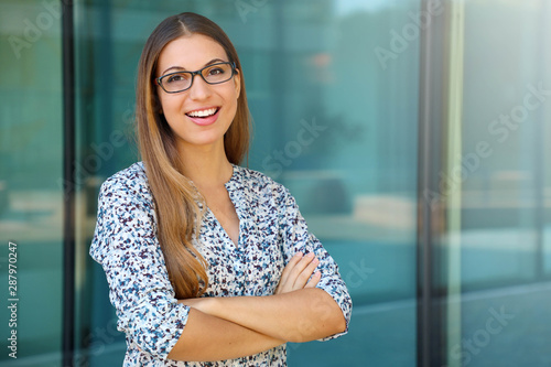 Successful business woman with crossed arms looks at camera Canvas