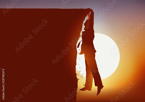 Fotografia, Obraz concept d'une situation périlleuse avec d'un homme qui se retrouve suspendu au d