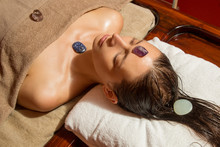 Woman In The Spa Having Energizing Crystal Massage