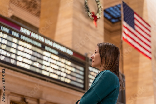 woman checking the train timetable in the grand central terminal in new york Wallpaper Mural