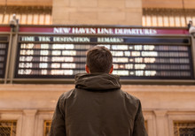 Man Checking The Train Timetab...