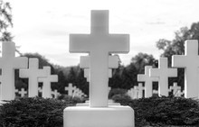 Many Identical White Crosses On The Cemetery.