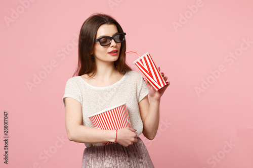 Beautiful young woman in 3d imax glasses posing isolated on pastel pink background Wallpaper Mural