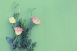 delicate bouquet of eustoma on a green background