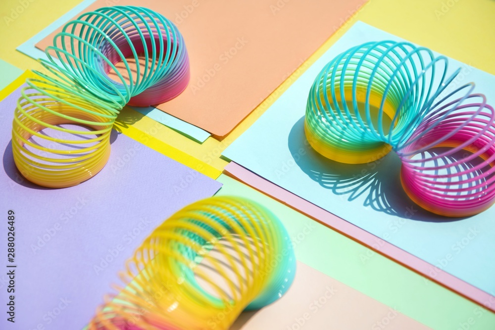 Fototapeta Close up of colorful slinky toys