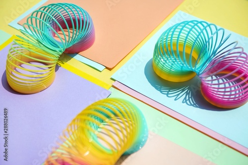 Photo sur Toile Spirale Close up of colorful slinky toys