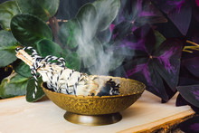 Brass Bowl And Burning Smudge With Violet Flower And Purple Shamrock