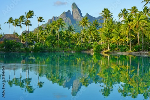 Fotomural View of the Mont Otemanu mountain reflecting in water at sunset in Bora Bora, Fr