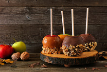 Autumn Candy Apples With Chocolate And Caramel, Side View On A Rustic Wood Platter