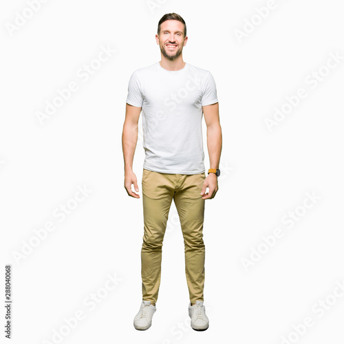 Fototapeta Handsome man wearing casual white t-shirt with a happy and cool smile on face. Lucky person. obraz