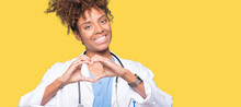 Young African American Doctor Woman Over Isolated Background Smiling In Love Showing Heart Symbol And Shape With Hands. Romantic Concept.