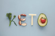 Leinwanddruck Bild - Keto word made from Ketogenic diet, low carb, healthy food on blue pastel background