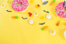 Halloween Candy.Halloween Holidays On Yellow Background, Colorful Decoration Toys, Baby Sweets, Donuts, Marmalade. Trick Or Treat, Terrible Night.halloween Background