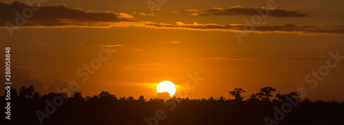 Fotografie, Obraz  The sun almost hidden! Sunset time over the sea at Sumatra, Indonesia