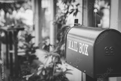 Fotografie, Obraz  Black and white of mailbox in front of the house with sunlight