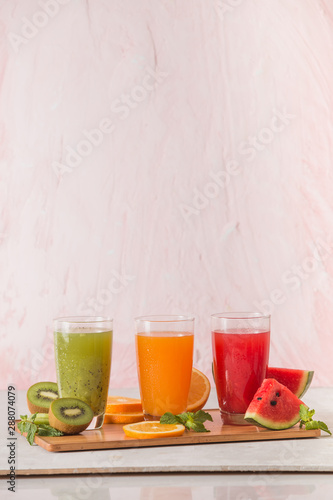Assortment of fruit and vegetables juice in glass Wallpaper Mural